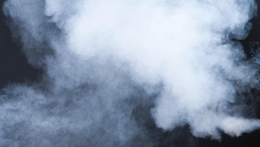 white and blue smoke isolated on black background